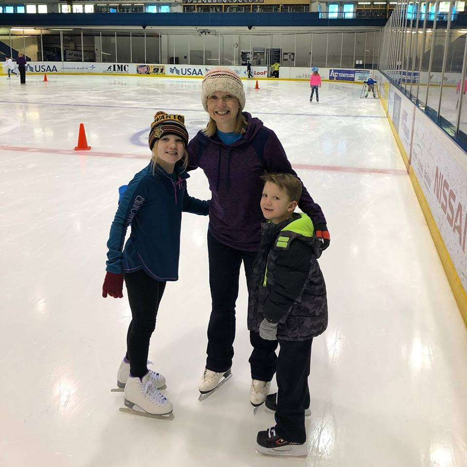 Megan on the ice with her two children